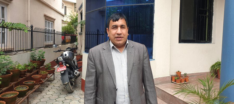 A picture of Amar Timalsina standing outside a building in Nepal