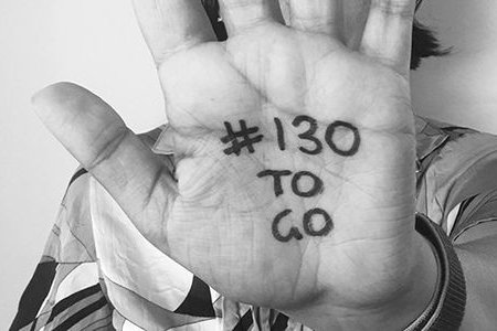 The palm of a hand has written on it '#130 to go'