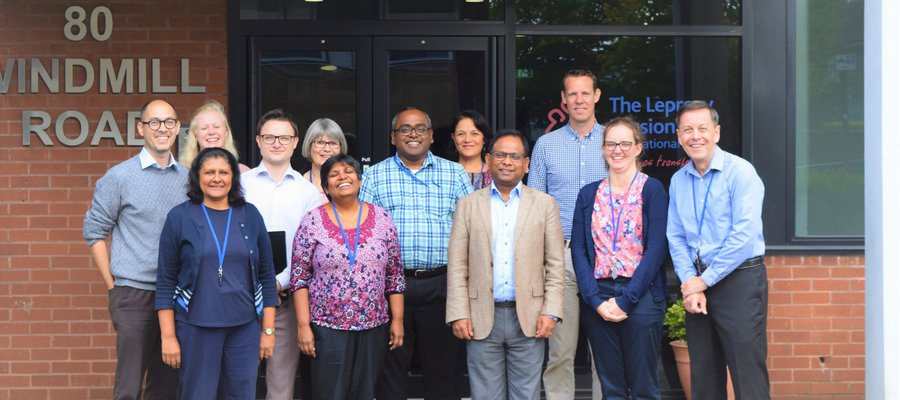 The staff of the International Office outside their office in Brentford