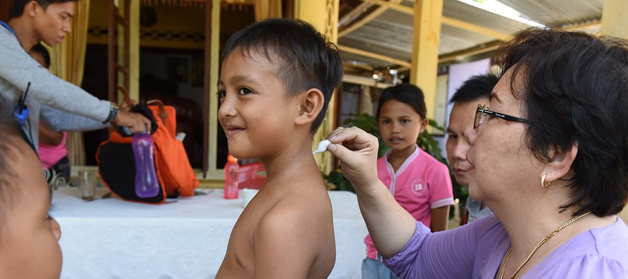 A boy being screened for leprosy in Indonesia.