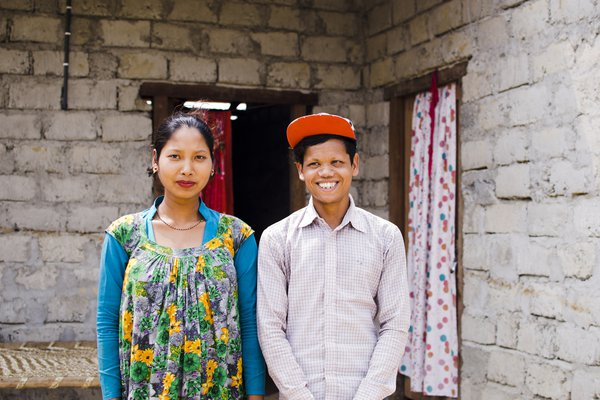 Young people in Nepal stand outside their home