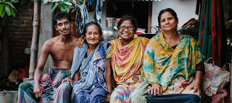 A family in Bangladesh smiles for the camera