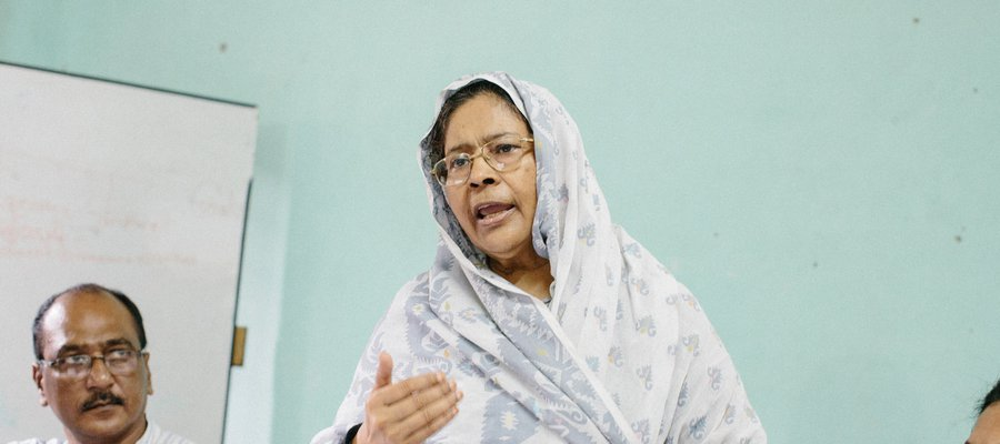 Momataze speaks at a meeting. She is the Founder of Mukti (Organisation working for women's rights and care, based in Kushtia).