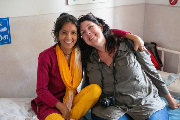 Parbati sits with a visiting TLM staff member