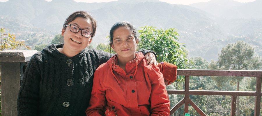 Rita sits with Nursing Superintendent Mahima Bantawa