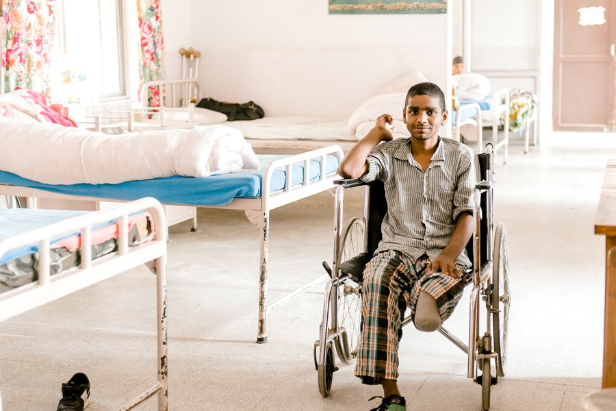 Mahendra sits in a wheelchair in Anandaban Hospital