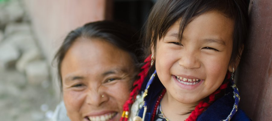Mother and daughter in Nepal smile at the camera