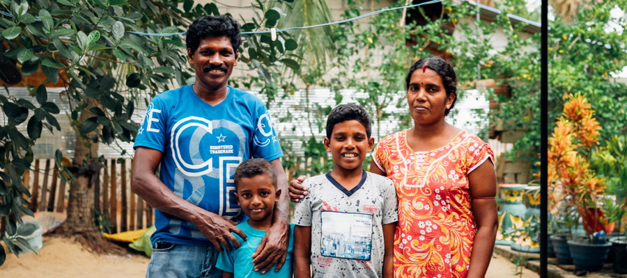 A family in Sri Lanka pose for a photo. They were denied access to school because of leprosy.