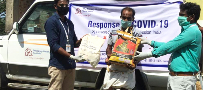 A man in India receives an emergency package during the pandemic
