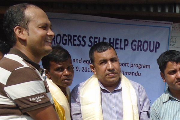 Tara, on the left, stands at the front of a celebration event in Nepal